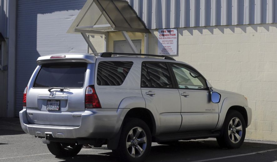 """FILE - In this March 3, 2017, file, photo, the Toyota 4Runner held in a Boston Police evidence lot in the Hyde Park neighborhood of Boston is seen during a """"view"""" of pertinent locations and evidence in the Aaron Hernandez trial. The vehicle, which prosecutors say Hernandez was in when he killed two men in 2012, is up for auction. The Boston Globe reports more than 60 people had placed bids on the Toyota 4-Runner on eBay as of Tuesday evening, May 2. The SUV's owner is a Rhode Island car dealer, who leased it to Hernandez as part of a promotional agreement. The former New England Patriots tight end was acquitted in the double slaying on April 14. He was in prison for the killing of a man who was dating his fiancee's sister. He hanged himself in his cell days later. (John Wilcox/The Boston Herald via AP, Pool, File)"""