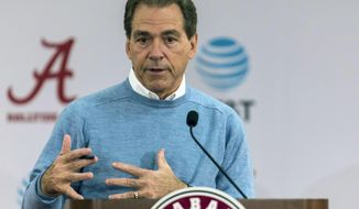 FILE - In this Jan. 13, 2017, file photo, Alabama NCAA college football coach Nick Saban speaks to the media in Tuscaloosa, Ala. University trustees approved a three-year extension through the 2024 season for Saban on Tuesday, May 2, 2017, that could pay him at least $65 million over the next eight years. (Vasha Hunt/AL.com via AP, File)