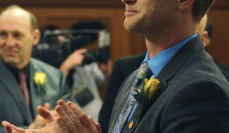 "In this Jan. 17, 2017, photo Alaska state Rep. David Eastman applauds in the House chamber in Juneau, Alaska. Eastman, a conservative lawmaker, has successfully tacked an anti-abortion message onto an otherwise innocuous resolution in the Alaska House aimed at raising awareness about sexual assault and child abuse, calling abortion ""the ultimate form of child abuse."" The measure's fate is unclear; bills typically only go to the full body if they have enough votes to pass. (AP Photo/Mark Thiessen)"