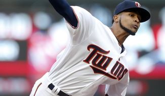 Minnesota Twins pitcher Ervin Santana throws against the Oakland Athletics during the first inning of a baseball game Tuesday, May 2, 2017, in Minneapolis. (AP Photo/Jim Mone)