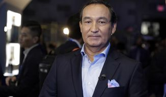 FILE - In this June 2, 2016, file photo, United Airlines CEO Oscar Munoz waits to be interviewed in New York. Munoz will be the star witness as Congress examines customer service by U.S. airlines and how air travel can be improved. The hearing by the House Transportation Committee comes amid worldwide outrage sparked when a passenger was dragged off a United flight after refusing to give up his seat to a crew member. The April 9 incident ignited a debate about poor service and a lack of customer-friendly policies on U.S. airlines. (AP Photo/Richard Drew, File)