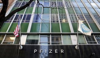 FILE - In this Monday, Nov. 23, 2015, file photo, flags fly in front of Pfizer World Headquarters, in New York. Pfizer Inc. reports earnings, Tuesday, May 2, 2017. (AP Photo/Mark Lennihan, File)