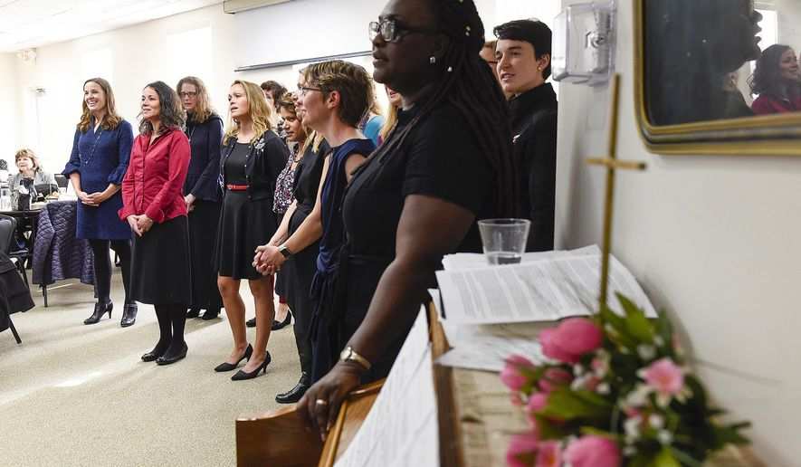 ADVANCE FOR WEEKEND EDITIONS, MAY 6-8 - In this Friday, April 28, 2017 photo, a community choir sings and shares memories of their groups founder after a memorial service at the Trinity Lutheran Church in Sauk Rapids, Minn. Mette Kirsch, the groups organizer, died of cancer in March. (Jason Wachter/St. Cloud Times via AP)