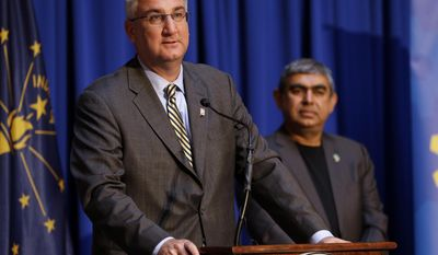 Indiana Gov. Eric J. Holcomb, left, and Dr. Vishal Sikka, CEO of Infosys, announces at the Statehouse in Indianapolis, Tuesday, May 2, 2017, plans for Infosys to increase its operations in the U.S, establishing four new state-of-the-art technology and innovation hubs in the U.S., with the first one in Indiana. (AP Photo/Michael Conroy)
