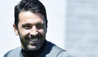 Juventus goalkeeper Gianluigi Buffon smiles during a training session at Vinovo Sports Center in Turin ahead of Wednesday's Champions League, semifinal first leg soccer match against Monaco, Tuesday,  May 2, 2017.  (Alessandro di Marco /ANSA via AP)