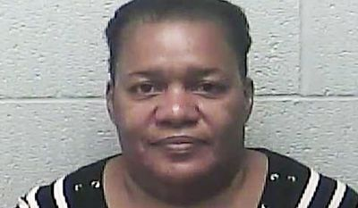 FILE - This April 2017 file photo provided by the Burleigh County Sheriff's Department in Bismarck, N.D., shows Dahlia Hunter, one of eight people who were extradited from Jamaica to face charges in the U.S. in what authorities say is a multimillion-dollar lottery scam that victimized dozens of Americans. Hunter pleaded not guilty in federal court Tuesday, May 2, 2017, in Bismarck, N.D. (Burleigh County Sheriff's Department via AP, File)