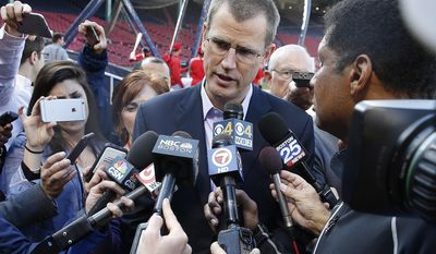 """Boston Red Sox president Sam Kennedy talks with reporters before a baseball game against the Baltimore Orioles, Tuesday, May 2, 2017, in Boston. Orioles outfielder Adam Jones called the incident in which he said fans inside Fenway Park yelled racial slurs at him and threw a bag of peanuts in his direction was """"unfortunate,"""" with no place in today's game. Kennedy said 34 people were ejected for various reasons Monday night and reiterated the team's """"zero tolerance"""" policy for such incidents. He also said there would be extra security around the outfield on Tuesday night. (AP Photo/Michael Dwyer)"""