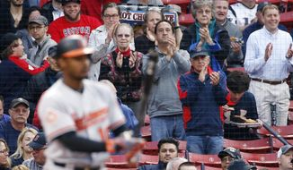 Fans give a standing ovation as Baltimore Orioles' Adam Jones comes to bat during the first inning of a baseball game against the Boston Red Sox, Tuesday, May 2, 2017, in Boston. (AP Photo/Michael Dwyer)
