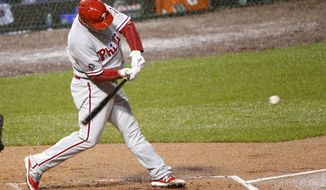 Philadelphia Phillies' Tommy Joseph swings into a three-run home run off Chicago Cubs starting pitcher Brett Anderson, also scoring Maikel Franco and Aaron Altherr during the first inning of a baseball game, Monday, May 1, 2017, in Chicago. (AP Photo/Charles Rex Arbogast)