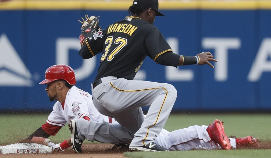 Cincinnati Reds' Billy Hamilton, left, steals second base against Pittsburgh Pirates second baseman Phil Gosselin (17) in the first inning of a baseball game, Tuesday, May 2, 2017, in Cincinnati. (AP Photo/John Minchillo)