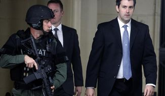 FILE - In this Monday, Dec. 5, 2016, file photo, former South Carolina police officer Michael Slager, right, walks from the Charleston County Courthouse under the protection of the Charleston County Sheriff's Department after a mistrial was declared for his trial in Charleston, S.C. Slager is pleading guilty to violating the civil rights of an unarmed black motorist he shot and killed during a 2015 traffic stop. A copy of the plea agreement obtained by The Associated Press Tuesday, May 2, 2017, also shows state prosecutors are dropping a pending murder charge against Slager. (AP Photo/Mic Smith, File)