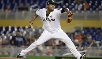 Miami Marlins starting pitcher Edinson Volquez throws during the first inning of an interleague baseball game against the Tampa Bay Rays, Tuesday, May 2, 2017, in Miami. (AP Photo/Lynne Sladky)