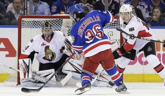 New York Rangers' Mats Zuccarello (36) shoots the puck past Ottawa Senators goalie Craig Anderson (41) and Senators' Ryan Dzingel (18) for a goal during the first period of Game 3 of an NHL hockey Stanley Cup second-round playoff series Tuesday, May 2, 2017, in New York. (AP Photo/Frank Franklin II)