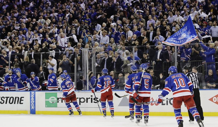 Fans celebrate after New York Rangers' Oscar Lindberg (24) scored a goal during the second period of Game 3 of the team's NHL hockey Stanley Cup second-round playoff series against the Ottawa Senators on Tuesday, May 2, 2017, in New York. (AP Photo/Frank Franklin II)