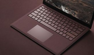This photo provided by Microsoft shows the company's Surface Laptop, aimed at students. The Surface Laptop is the first Surface device without a detachable keyboard. (Courtesy of Microsoft via AP)