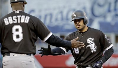 Chicago White Sox's Geovany Soto (18) celebrates with first base coach Daryl Boston (8) after hitting an RBI single during the second inning of the team's baseball game against the Kansas City Royals on Tuesday, May 2, 2017, in Kansas City, Mo. (AP Photo/Charlie Riedel)