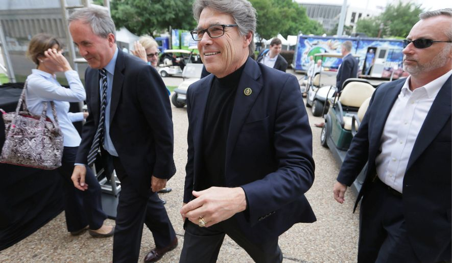 Energy Secretary Rick Perry (center) used to boast of how often he sued the Obama administration over environmental and energy issues when he was governor or Texas, but he now faces a lawsuit from his own state to recover funds for an unused nuclear waste site in Nevada. (Associated Press)