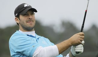 Dallas Cowboys quarterback Tony Romo follows his drive from the ninth tee of the Pebble Beach Golf Links during a practice round of the AT&T Pebble Beach National Pro-Am PGA Tour golf tournament in Pebble Beach, Calif., Tuesday, Feb. 7, 2012. (AP Photo/Eric Risberg) **FILE**