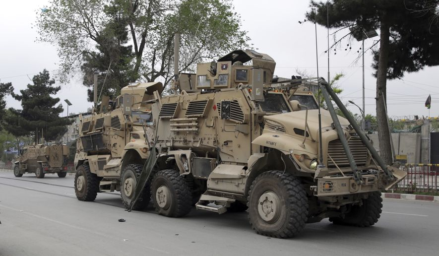 A damaged U.S. military vehicle is pictured at the site of a suicide attack in Kabul, Afghanistan, Wednesday, May 3, 2017. (AP Photos/Massoud Hossaini) ** FILE **