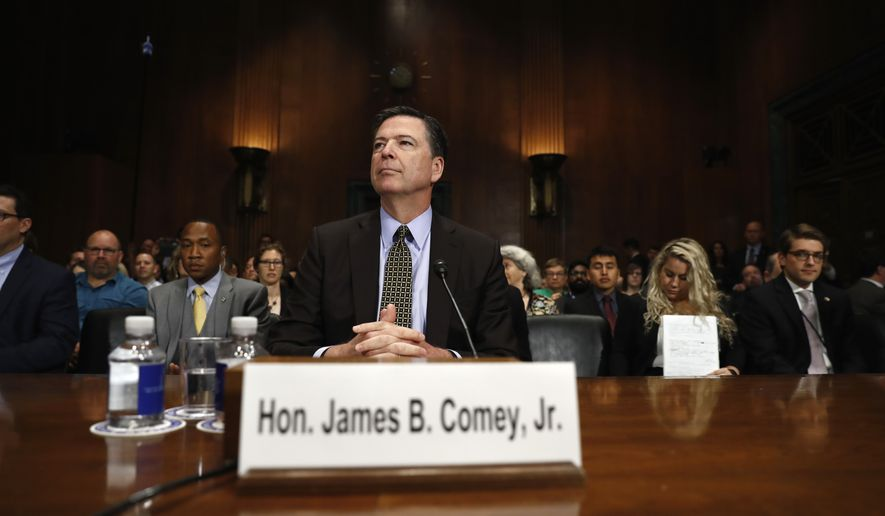 """FBI Director James B. Comey prepares to testify on Capitol Hill in Washington, Wednesday, May 3, 2017, before the Senate Judiciary Committee hearing: """"Oversight of the Federal Bureau of Investigation."""" (AP Photo/Carolyn Kaster)"""