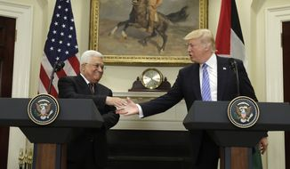 President Donald Trump shakes hands with Palestinian leader Mahmoud Abbas during their news conference in the Roosevelt Room of the White House, Wednesday, May 3, 2017, in Washington. (AP Photo/Evan Vucci)