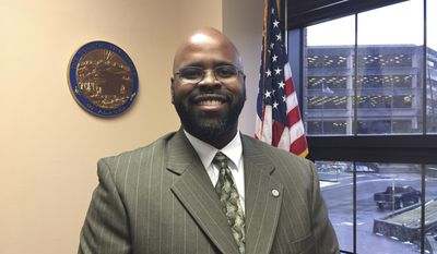 This Jan. 23, 2017, file photo shows Alaska state Sen. David Wilson posing in his Capitol office in Juneau, Alaska. A reporter for the Alaska Dispatch News on Wednesday, May 3, 2017, claimed Wilson slapped him Tuesday in a Capitol stairwell when the reporter sought Wilson's opinion on a recently published article. (AP Photo/Becky Bohrer, File)