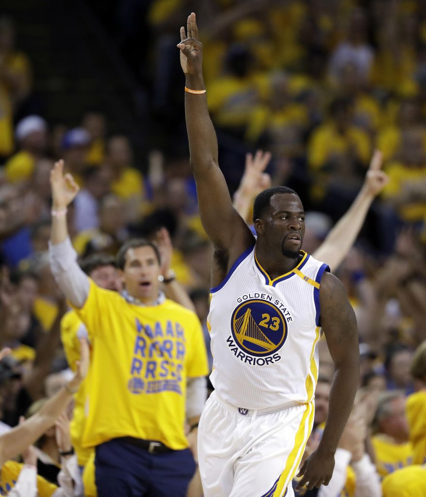 Golden State Warriors' Draymond Green (23) signals after making a 3-point basket against the Utah Jazz during the second half in Game 1 of an NBA basketball second-round playoff series, Tuesday, May 2, 2017, in Oakland, Calif. (AP Photo/Marcio Jose Sanchez)