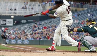 Minnesota Twins' Kennys Vargas hits a two-run single off Oakland Athletics pitcher Kendall Graveman in the first inning of a baseball game, Wednesday, May 3, 2017, in Minneapolis. (AP Photo/Jim Mone)