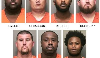 This combo of booking photos released by the Clarksville, Tenn., Police Department shows, top row from left, William L. Byles, Kenneth Chiasson, Antwon D. Keesee and Jonathan Schnepp; bottom row from left, Roger D. West, Prentice L. Williams and Joshua Young. Tennessee police say the seven bounty hunters and bail bondsmen have been indicted on first-degree murder and other charges in the killing of an unarmed man and the wounding of another. Authorities say 24-year-old Jalen Johnson and another man were wounded April 23, 2017, after the bounty hunters and bail bondsmen confronted Johnson and his three friends in a Wal-Mart parking lot in Clarksville, Tenn. Police said that neither Johnson nor his three friends had outstanding warrants. (Clarksville Police Department via AP)