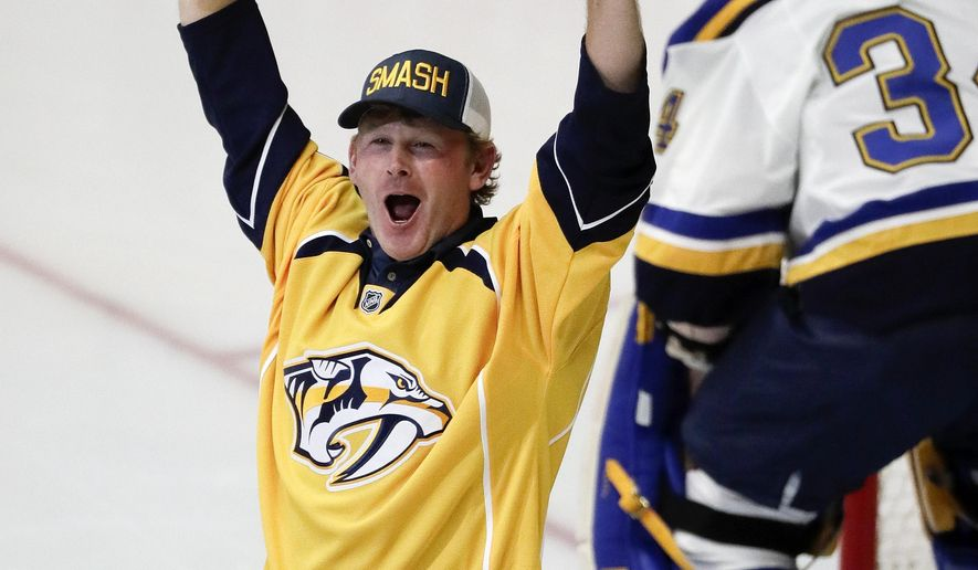 Professional golfer and Nashville, Tenn. native Brandt Snedecker pumps up the crowd before the first period in Game 4 of a second-round NHL hockey playoff series between the Nashville Predators and the St. Louis Blues Tuesday, May 2, 2017, in Nashville. (AP Photo/Mark Humphrey)