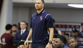 FILE - In this Jan. 16, 2017, file photo, Nathan Hale's head coach Brandon Roy is seen on the sidelines against Oak Hill Academy during a high school basketball game at the 2017 Hoophall Classic, in Springfield, Mass. Authorities say former NBA player Brandon Roy was shot while attending a party in Southern California over the weekend. Los Angeles County sheriff's Lt. Joseph Williams said Wednesday, May 3, 2017, that Roy was one of four people shot in Compton on Saturday. (AP Photo/Gregory Payan, File)