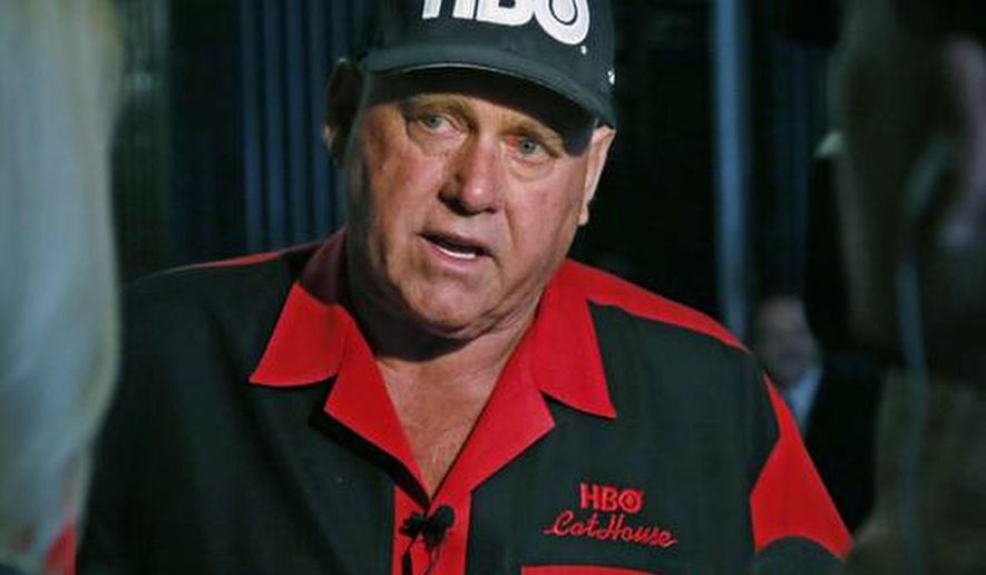 FILE - In this June 13, 2016, file photo, Dennis Hof, owner of the Moonlite BunnyRanch, a legal brothel near Carson City, Nevada, is pictured during an interview in Oklahoma City. Hof, Nevada's best-known legal brothel owner is being accused of violating regulations at a property he owns near a desert crossroads outside Las Vegas. Nye County Commission Chairman Dan Schinhofen, says Hof faces possible commission discipline May 17, 2017, on two code violations found at his brothel in Amargosa Valley. (AP Photo/Sue Ogrocki, File)