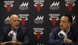 Chicago Bulls Executive Vice President of Basketball Operations John Paxson, left, speaks as General Manger Gar Forman looks on during an end-of-season press conference at the United Center in Chicago, Wednesday, May 3, 2017. (Jim Young/Chicago Tribune via AP)