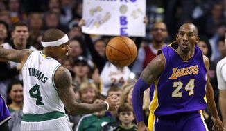 This Dec. 30, 2015, file photo shows Los Angeles Lakers' Kobe Bryant and Boston Celtics' Isaiah Thomas eyeing a loose ball during the second half of an NBA basketball game in Boston. (AP Photo/Winslow Townson) ** FILE **