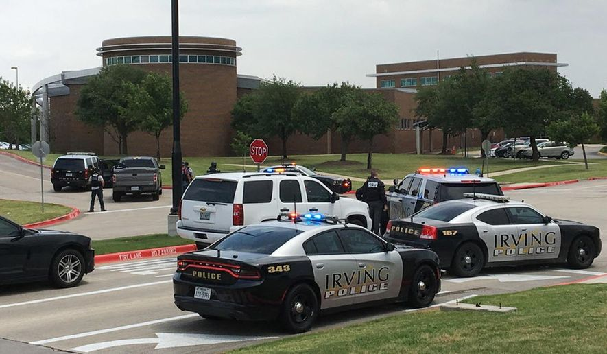 Officers work at a shooting scene on the North Lake College campus in Irving, Texas, Wednesday, May 3, 2017. The situation prompted a lockdown at the school in the Dallas suburb. (Jae S. Lee/The Dallas Morning News via AP)