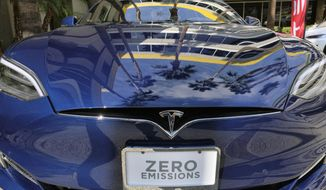 This Monday, Oct. 24, 2016, photo shows a Tesla Model S on display in downtown Los Angeles. Tesla Inc. reports earnings Wednesday, May 3, 2017. (AP Photo/Richard Vogel)