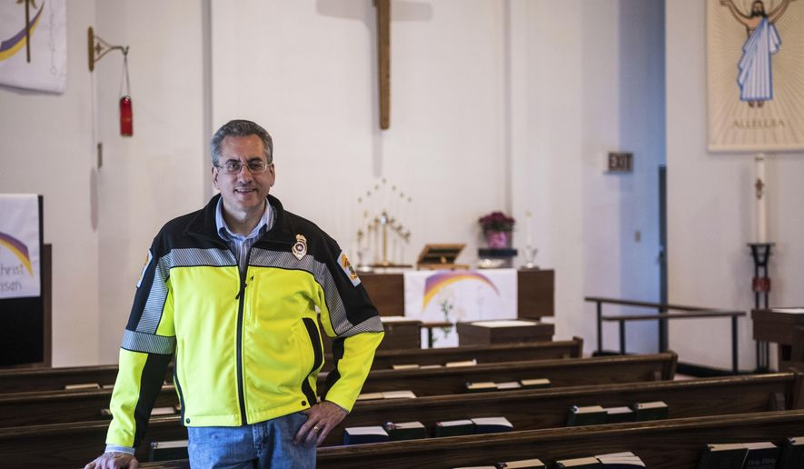 In this April 21, 2017 photo, Rev. Roger L. Steiner, the new chaplain for the Penn Township Police, poses for a portrait at his home parish Penn-Zion's Lutheran Church in Harrison City, Pa. (Dan Speicher/Pittsburgh Tribune-Review via AP)
