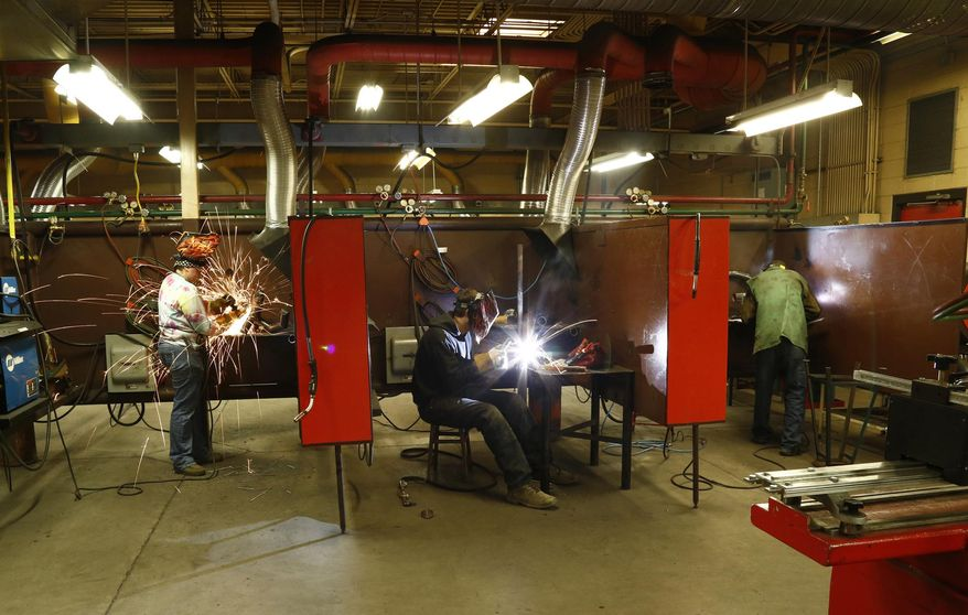 ADVANCE FOR WEEKEND EDITIONS - In this March 2, 2017, photo, students learn skills in the welding program at Northwest College in Powell, Wyoming. Despite layoffs in the oil field, welders are still in high demand, and enrollment in the college's welding program is increasing, said Bill Johnson, coordinator of the program. (Ilene Olson/The Powell Tribune via AP)