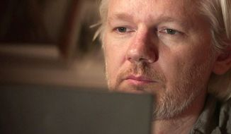 "This image released by Showtime shows Julian Assange in a scene from the documentary ""Risk."" (Praxis Films/Showtime via AP)"