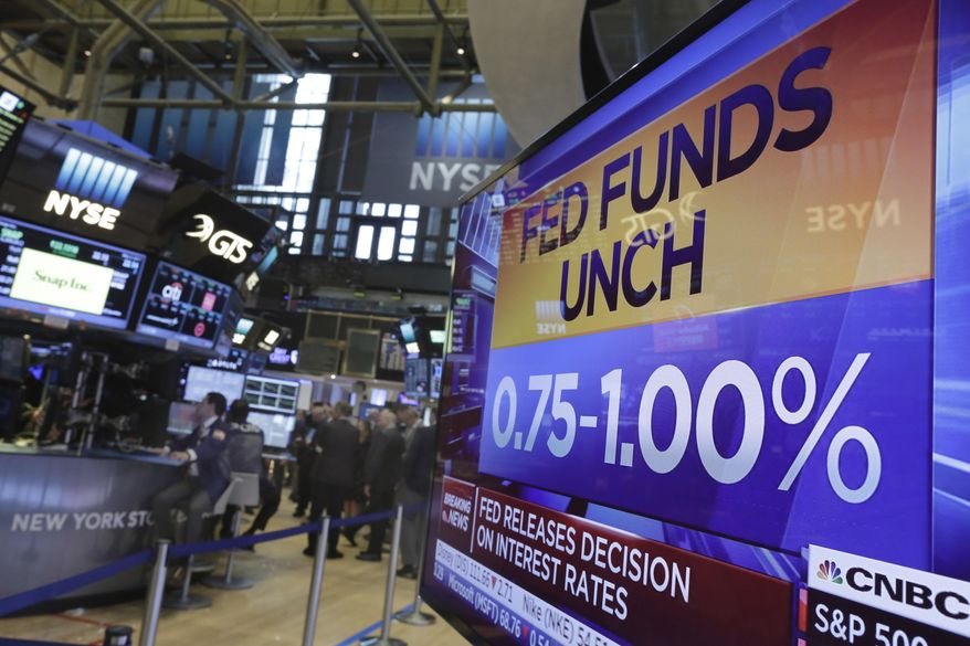 A television screen on the floor of the New York Stock Exchange shows the rate decision of the Federal Reserve, Wednesday, May 3, 2017. The Federal Reserve is leaving interest rates unchanged, while signaling that it expects a resilient U.S. economy and solid job market to justify further rate hikes later this year. (AP Photo/Richard Drew)