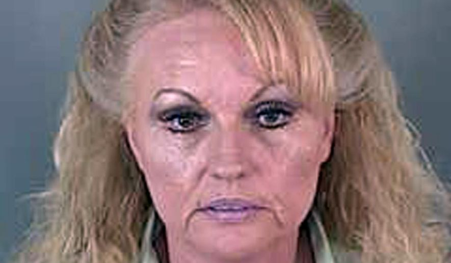 FILE - This undated file photo provided by Lane County Corrections shows Pamela Gygi. On Wednesday, May 3, 2017, Gygi was sentenced in Eugene, Ore., to 10 years in federal prison for a murder-for-hire scheme that unraveled when the felon she hired to kill her ex-husband drove to Utah and alerted him to the plot. (Lane County Corrections via AP, file)