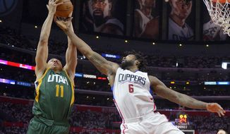 Utah Jazz guard Dante Exum, left, of Australia, grabs a rebound away from Los Angeles Clippers center DeAndre Jordan during the second half in Game 7 of an NBA basketball first-round playoff series, Sunday, April 30, 2017, in Los Angeles. The Jazz won 104-91. (AP Photo/Mark J. Terrill)