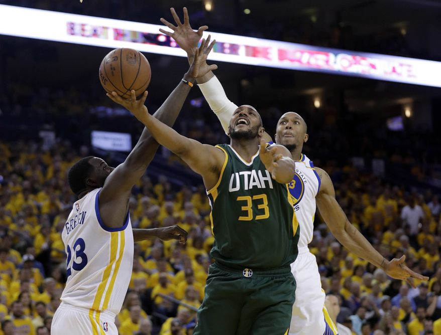 Utah Jazz's Boris Diaw (33) shoots as Golden State Warriors' Draymond Green (23) and David West, right, defend during the second half in Game 1 of an NBA basketball second-round playoff series, Tuesday, May 2, 2017, in Oakland, Calif. (AP Photo/Marcio Jose Sanchez)