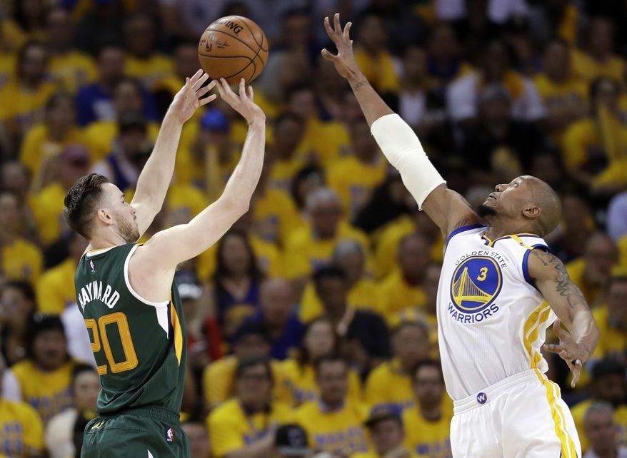 Utah Jazz's Gordon Hayward (20) shoots over Golden State Warriors' David West (3) during the first half in Game 1 of an NBA basketball second-round playoff series, Tuesday, May 2, 2017, in Oakland, Calif. (AP Photo/Marcio Jose Sanchez)