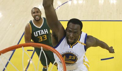 Golden State Warriors' Draymond Green (23) dunks past Utah Jazz's Boris Diaw (33) during the second half in Game 1 of an NBA basketball second-round playoff series, Tuesday, May 2, 2017, in Oakland, Calif. (Ezra Shaw/Pool Photo via AP)