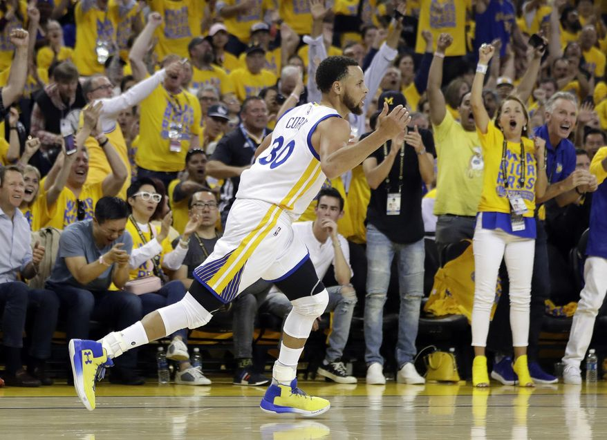 Golden State Warriors' Stephen Curry (30) celebrates after scoring against the Utah Jazz during the first half in Game 1 of an NBA basketball second-round playoff series, Tuesday, May 2, 2017, in Oakland, Calif. (AP Photo/Marcio Jose Sanchez)