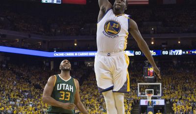 Golden State Warriors' Draymond Green (23) dunks past Utah Jazz's Boris Diaw (33) during the second half in Game 1 of an NBA basketball second-round playoff series, Tuesday, May 2, 2017, in Oakland, Calif. (Kyle Terada/Pool Photo via AP)