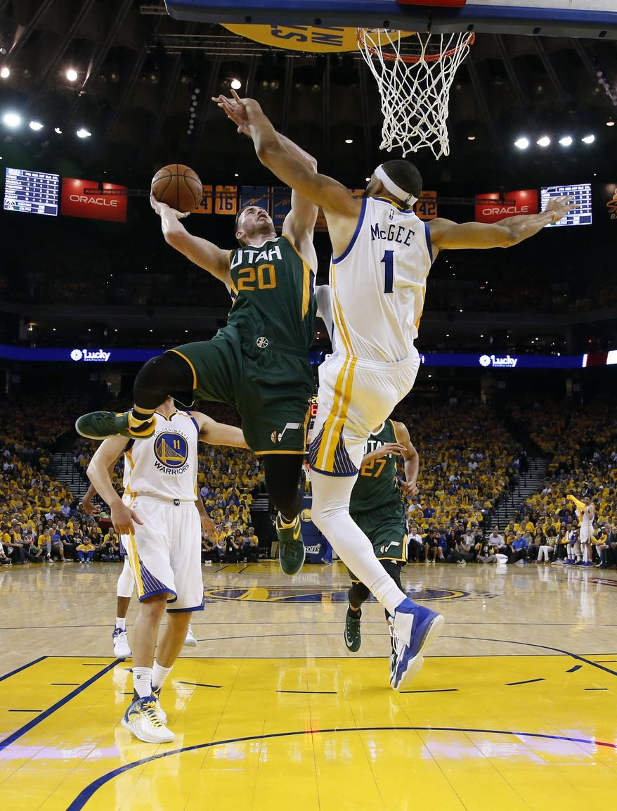 Utah Jazz's Gordon Hayward (20) drives to the basket as Golden State Warriors' JaVale McGee (1) defends during the second half in Game 1 of an NBA basketball second-round playoff series, Tuesday, May 2, 2017, in Oakland, Calif. (AP Photo/Marcio Jose Sanchez)