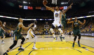 Golden State Warriors' Stephen Curry (30) scores against the Utah Jazz during the first half in Game 1 of an NBA basketball second-round playoff series, Tuesday, May 2, 2017, in Oakland, Calif. (AP Photo/Marcio Jose Sanchez)