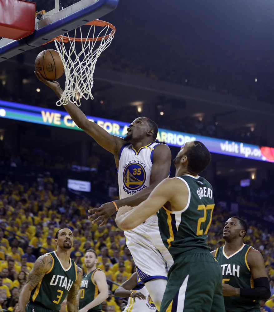Golden State Warriors forward Kevin Durant (35) drives past Utah Jazz center Rudy Gobert (27) during the first half in Game 1 of an NBA basketball second-round playoff series, Tuesday, May 2, 2017, in Oakland, Calif. (AP Photo/Marcio Jose Sanchez)